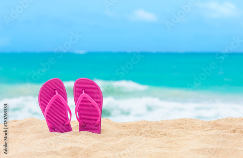 Pair of slippers on a tropical beach. (location Hawaii)