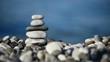 balancing stones against morning sea