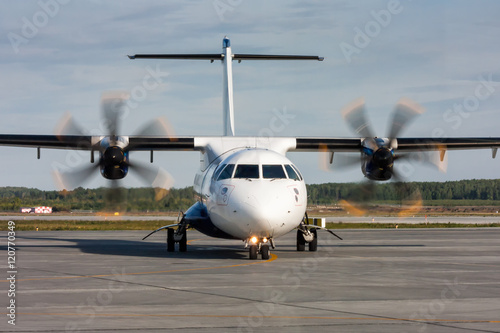Photo  Taxiing turboprop airplane from the runway
