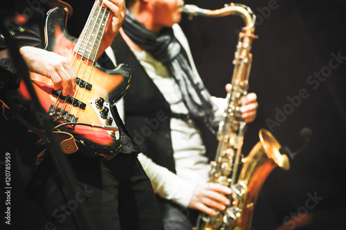Photo  Guitar player and saxophonist on a stage