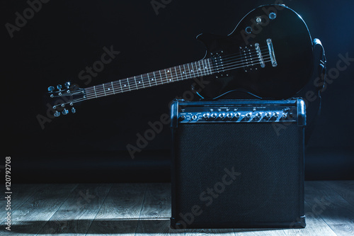 electric guitar and classic amplifier on a dark background Canvas Print