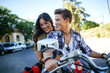 Happy young couple on a motorbike