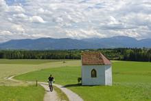 Germany, Bavaria, Faistenberg Near Beuerberg, Cyclist At Otthof Chapel