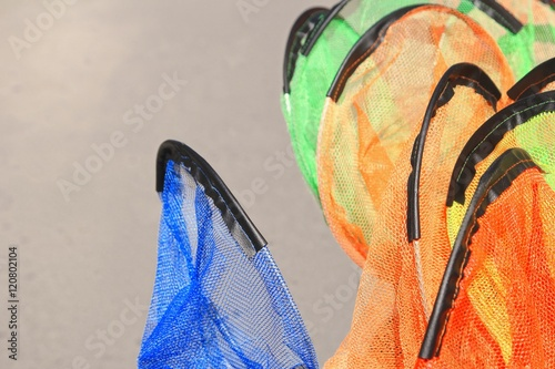 Fototapety, obrazy: Kids fishing nets stacked for sale, orange, blue, green,shallow focus