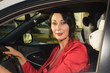 Adult confident businesswoman driving car.