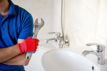 Plumber With Wrench Standing I...