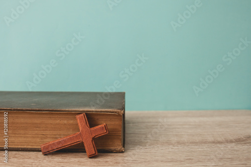 Fototapeta  wood cross with bible on table