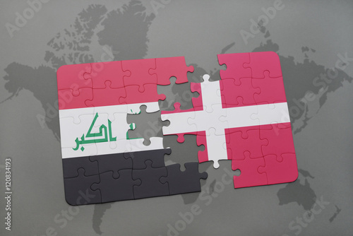 puzzle with the national flag of iraq and denmark on a world map background Poster