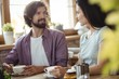 Couple interacting with each other while having coffee