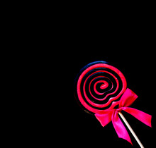 Black And Pink Lollipop With Pink Bow Tie
