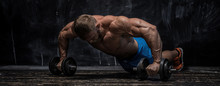 Muscular Bodybuilder Guy Over Darck Background