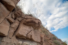 Cracks On The Rock Of Sandstone, Grass Grows On The Rock. Natural Concept, Weathering Of Rocks