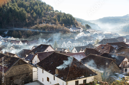 Smoking chimneys in the village of Ochagavia