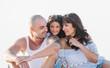 Portrait of happy family hugging on beach