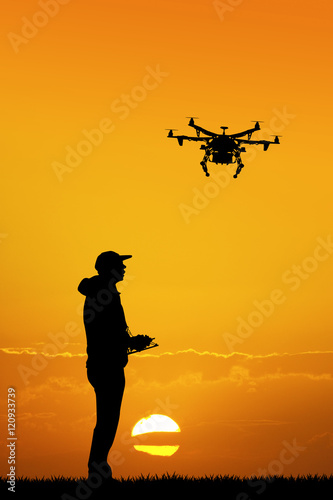 man with drone at sunset Wall mural