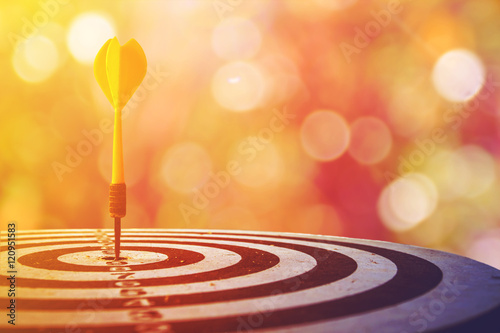 Fotografía  target dart with arrow over blurred bokeh background ,metaphor to target marketing or target arrow concept