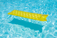 Yellow Raft Floating In A Pool