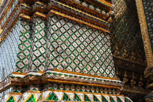 The pattern on the wall inside the Grand Palace in Bangkok Thailand