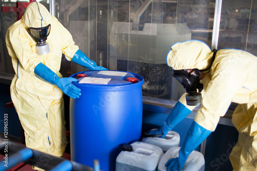 Fotografie, Obraz  Workers in protective suits with toxic waste