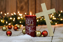 Holiday Candle With Wood Cross And Christmas Decorations