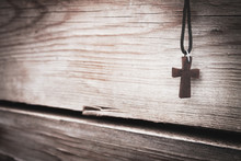 Cross In The Wooden Table