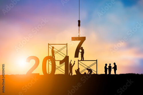 Poster  Silhouette employees work as a team to change the 6 to 7, 2017 Happy New Year ba