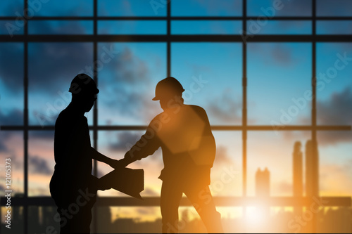 Fotografie, Obraz  Silhouette engineer standing orders for construction crews to work safely on high ground over blurred natural background sunset pastel