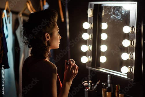 Fotografia, Obraz Confident female model doing make-up backstage
