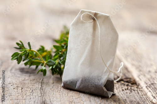 tea bag and fresh thyme