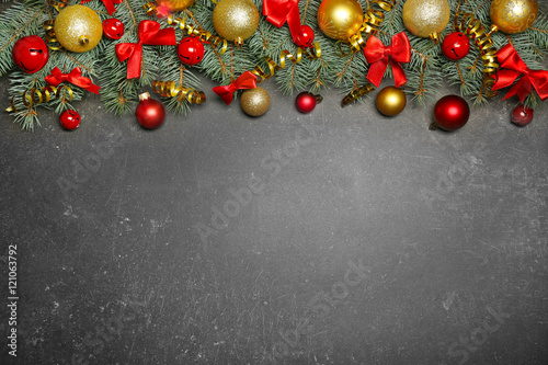Christmas composition with fir tree branches and festive decoration on gray background