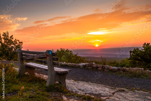 Valokuva  A lone bench looks over the mountain at sunset at the top of New Jersey, High Po