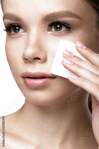 Beautiful young girl with wipes for removing makeup and French manicure Canvas-taulu