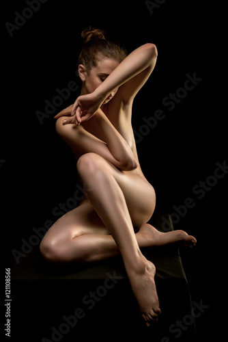 Perfect flexible sexy body of young woman.Art nude