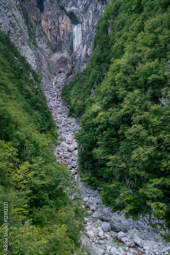 Foto op Canvas Olijf Boka waterfall surrounded by forest in Triglav National Park, Sl