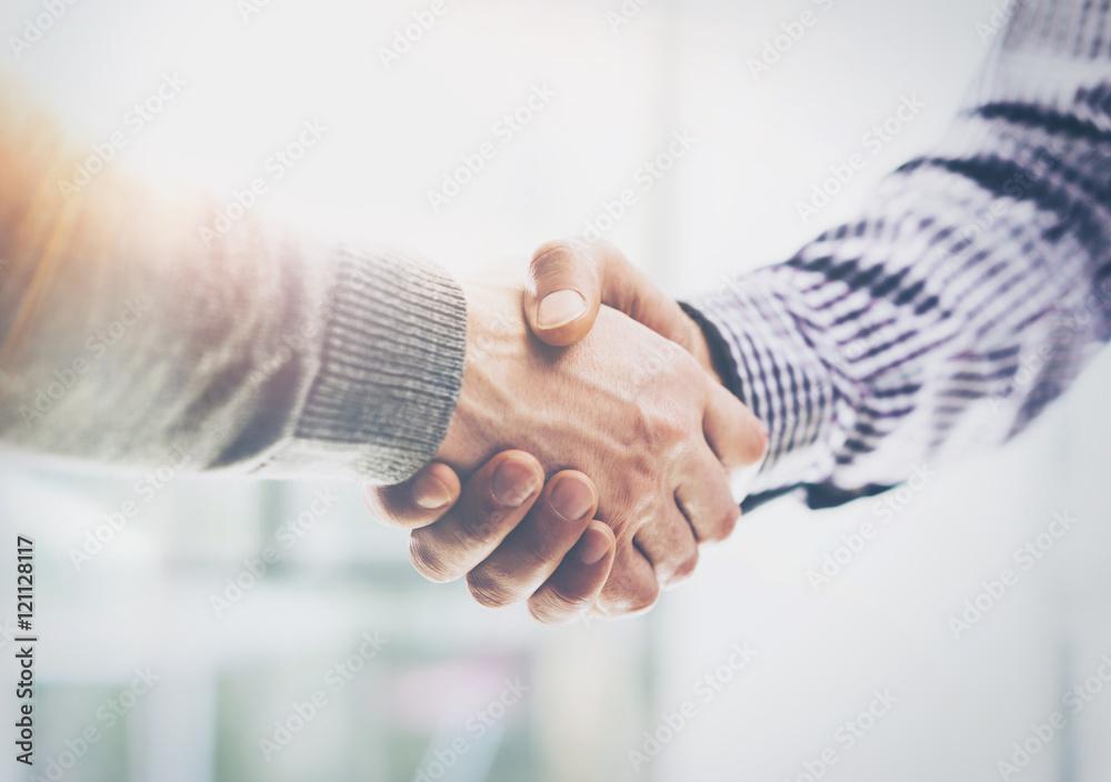 Fototapeta Business Partnership Meeting.Photo Two Businessmans Hands Handshake Process.Successful Businessmen Handshaking After Great Deal.Horizontal, Blurred Background.