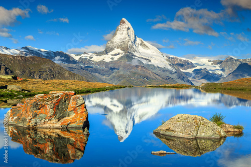 Fotografie, Obraz  Autumn landscape with Matterhorn peak and Stellisee lake,Valais,Switzerland