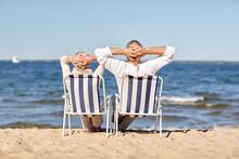 Senior Couple Sitting On Chair...