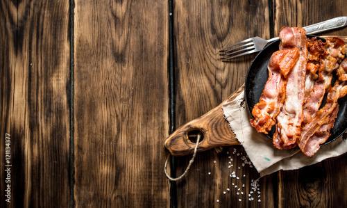 Fried bacon in a frying pan Wallpaper Mural