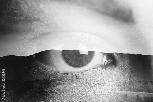 Double exposure of an eye with mountain Canvas Print