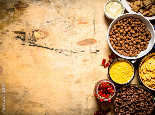 Printed kitchen splashbacks Spices Cereal in cups. On wooden background.