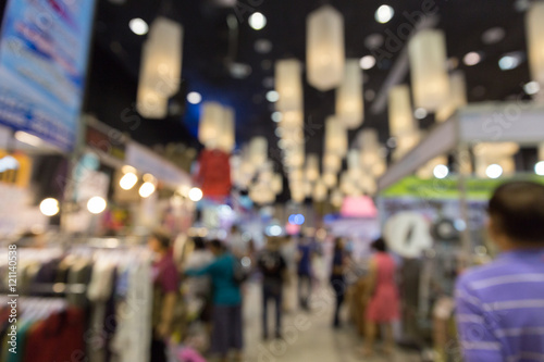 Valokuva  people shopping in exhibition trade fair - blur