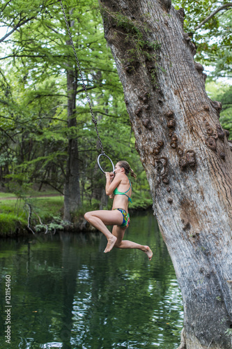 Foto op Canvas Texas The Blue Hole in Wimberley, Texas is a popular destination for tourists and locals on hot summer days. The clear, cool water flows through cypress trees and offers a refuge from the Texas heat.