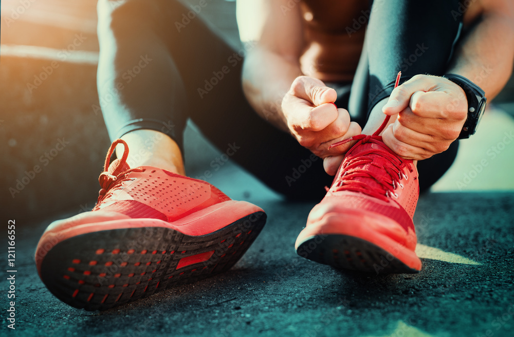 Fototapety, obrazy: Tying sports shoes