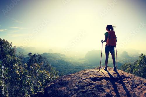 Obraz successful woman hiker at sunrise mountain peak - fototapety do salonu