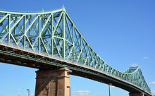 The Jacques Cartier Bridge Is A Steel Truss Cantilever Bridge Crossing The Saint Lawrence River From Montreal To Longueuil In Montreal, Quebec, Canada