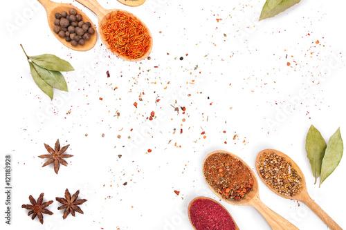 Foto auf Gartenposter Gewürze 2 Different spices in spoons on white background