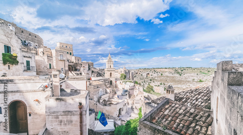 Foto auf Gartenposter Kunstdenkmal panoramic view of typical stones (Sassi di Matera) and church of Matera under blue sky