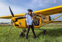 On A Green Field Girl In Ultralight Aircraft.