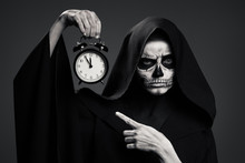 Scary Death Hold A Watch In Hi...