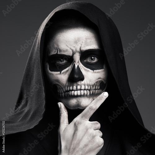 Fotografering  Scary Death Ponders Supporting His Head Arm. Realistic Skull Mak